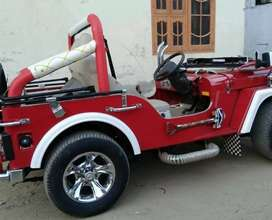 Modified red rosy coloured willy jeep