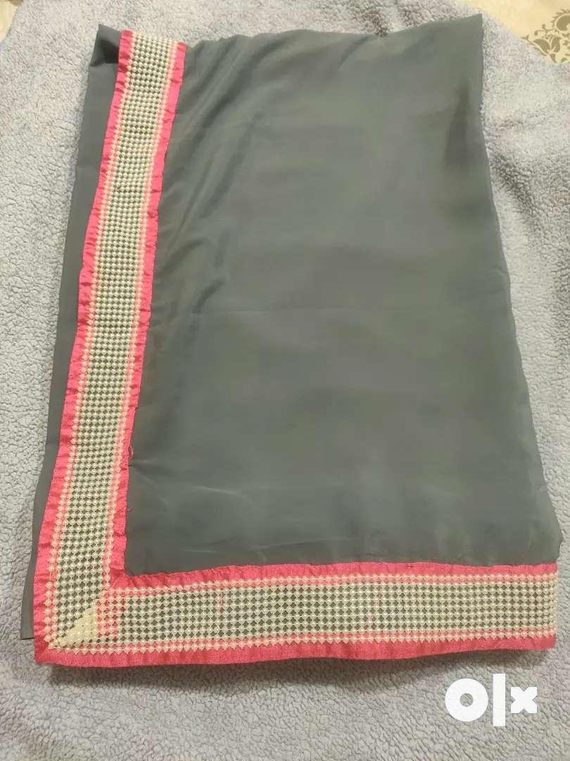 Grey saree with pearl lase