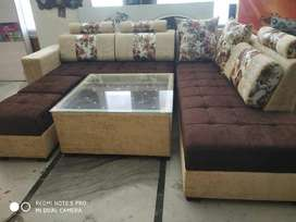 Brand new L shape sofa set with 1 center table and 2 puffies.