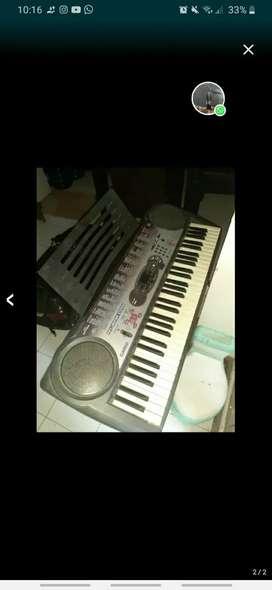 Keyboard Casio LK - 35 (keyboard stand & book holder)