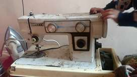 2 sewing machine for sale . normal condition