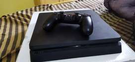 Ps4 slim 1 tb in mint condition with five games urgent sale