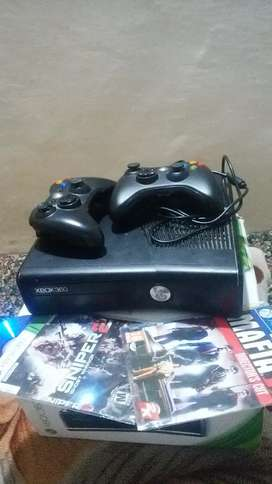 XBOX 360 SLIM 300GB HARDDRIVE AND TWO CONTROLLERS