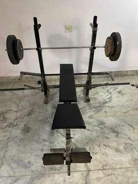 Bench press machine with weights