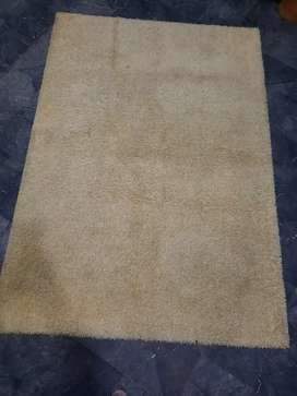 I m selling off-white soft carpet size 8 by 5 feet in good condition