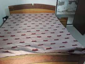 Double Bed with storage, along with side table and branded mattress.
