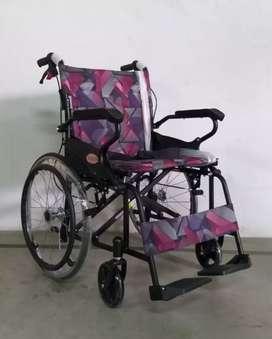 Kursi roda avico travelling hitam motif
