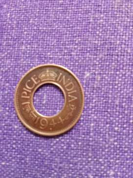 1 paisa coin with a hole