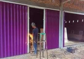 Folding gate rolling door