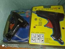 Glue guns both with glue