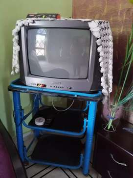 Tv for sale in a good condition with movable table