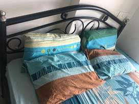Queen size metal storage bed with mattress and 4 pillows