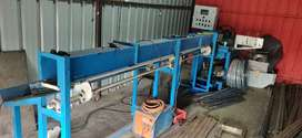 Chain link fencing manufacturing machine