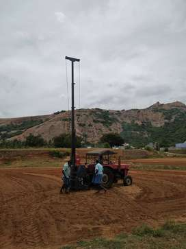 Tractor bore motor crane