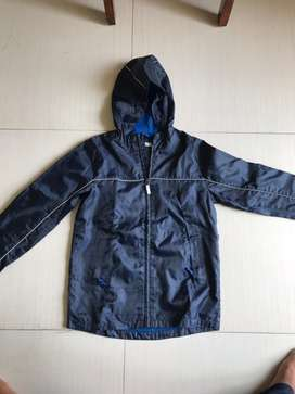 Rain coat blue from debenhum's Uk for 8 to 11 year boy