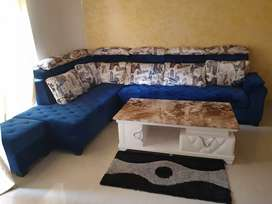L shaped big size sofa with 2 puffy with centre table