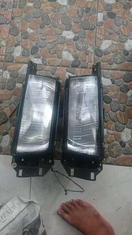 Headlamp original sepasang koito mazda 323 INTERPLAY