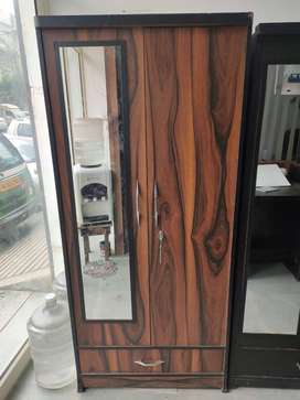 New wooden wardrobe with mirror in laminated board