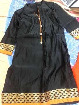 Small size black and orange patilla suit