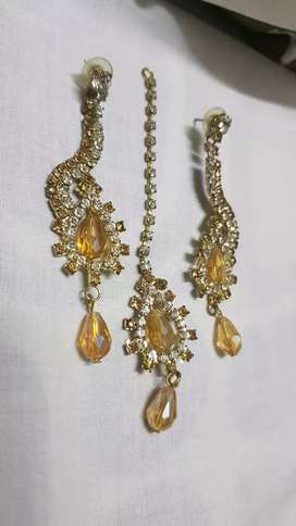 Golden earings with tika