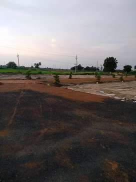 Premium gated community plots at eluru facing 6 lane High way