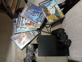 PS2 WITH 4-5 GAME CD