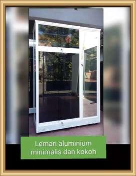Lemari baju aluminium kaca minimalis pintu sliding + bukaan biasa