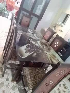 6 seated dining table with glass table and wooden seats