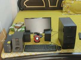 Computer with accesories like keyboard , mouse , cpu , speaker , wires