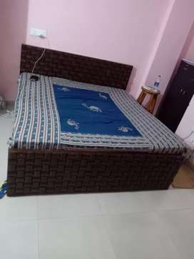 Double bed with mattress.