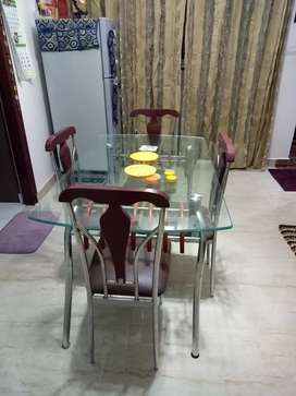 Malaysian wood double glass dining table.