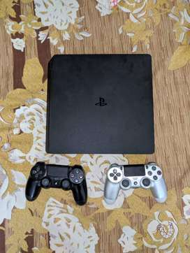 PlayStation 4 (PS4) Slim 1TB with 2 controllers