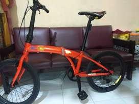 sepeda lipat modifan warna oren
