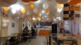 Staff required for preparing fastfood in a fastfood cafe.