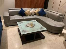 sofa set 1 year old in brand new condition . 7 seater L shaped sofa