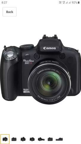 Canon PowerShot SX1IS 10 MP CMOS Digital Camera with free accessories