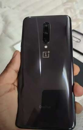 One plus 7 pro in better condition with warranty card