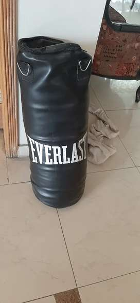 Sand bag with boxing gloves