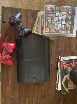PS3 with 2 controllers, 11 games(including GTA 5)