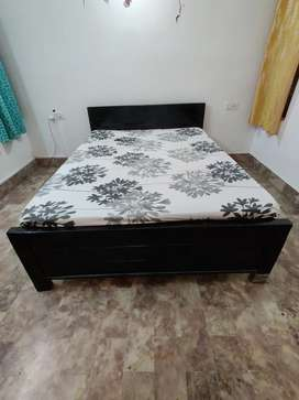5feet by 7 feet wooden bed with plywood center and mattress