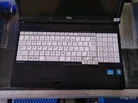 Laptop fujitsu core i3 ram 4GB garansi 6 bulan mulus