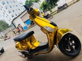 Golden vespa SXL 150
