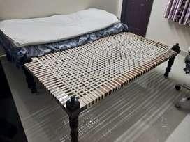 Two navar cots along with cotton matrixes