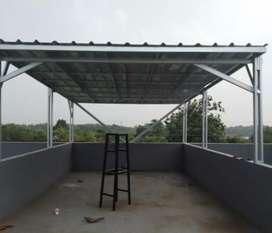 Pemasangan rangka atap baja ringan.