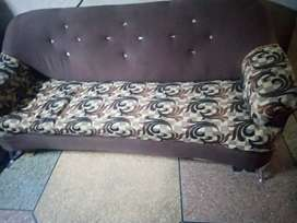 Five seater sofa with stain less steel legs and pure wood