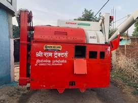 Tractor mounted mini harvestor