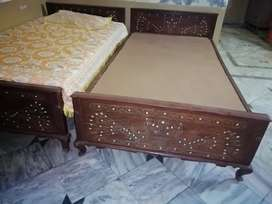 two wooden single beds