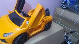 Kids riding electric car and bike at clearance sale