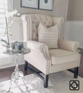 Cream Fabric Wings chair for Middle room.  With 5 years of warranty