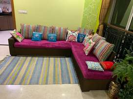L type sofa with eight cushions and two covers
